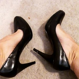 Worn black heels